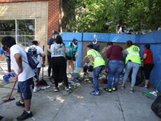 Volunteers help cleanup Cicero street one June 2, 2020 following the George Floyd protests