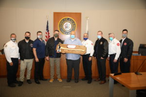 "Town President Larry Dominick receives a ""Golden Axe"" from the Firefighters and union leaders for his strong support of the Fire Department. Photo courtesy of the Town of Cicero and Gerardo Lopez."